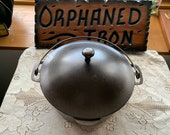 Unmarked Wagner 8 Dutch Oven With Whistle Top Basting Lid.