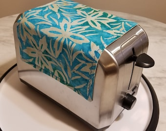 Toaster Huggee® Keep dust away with a Toaster Huggee® toaster cover today! 2&4 Slice Available