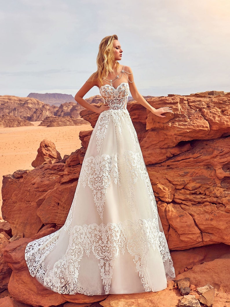 Beautiful wedding dress with big lace elements Romantic image 0