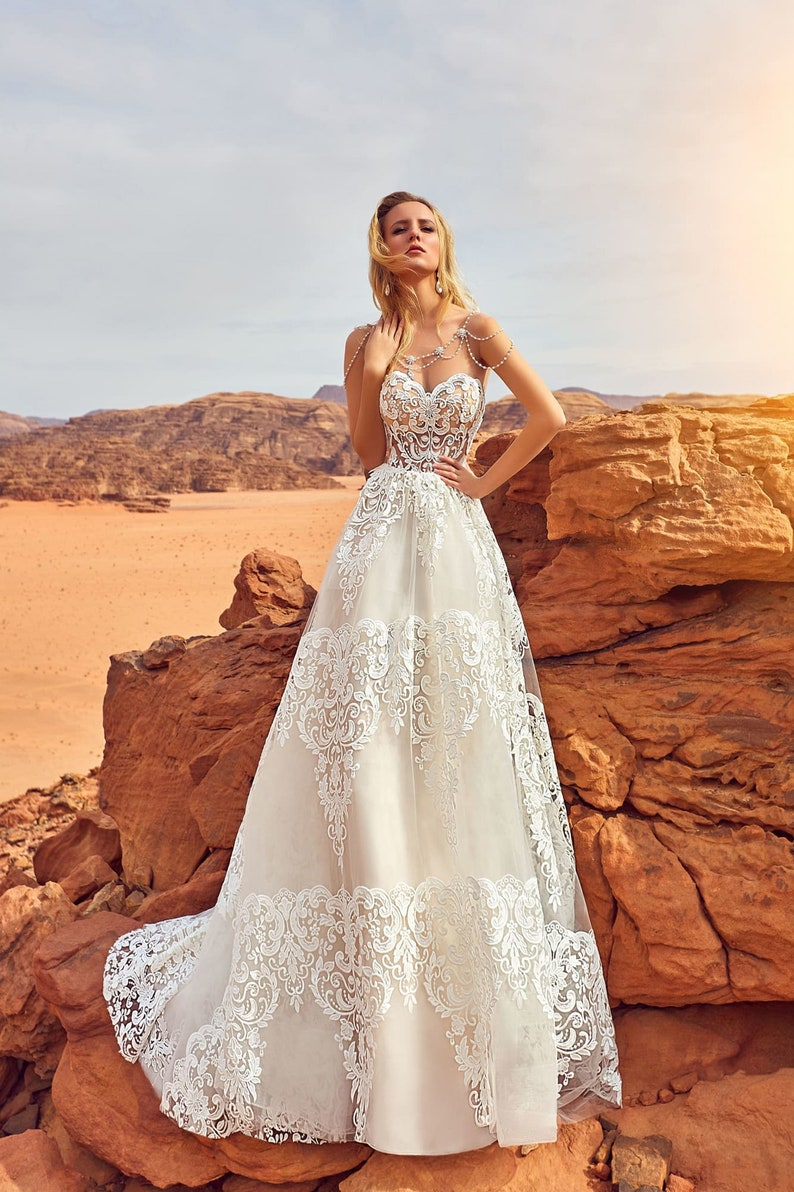 Beautiful wedding dress with big lace elements Romantic image 2