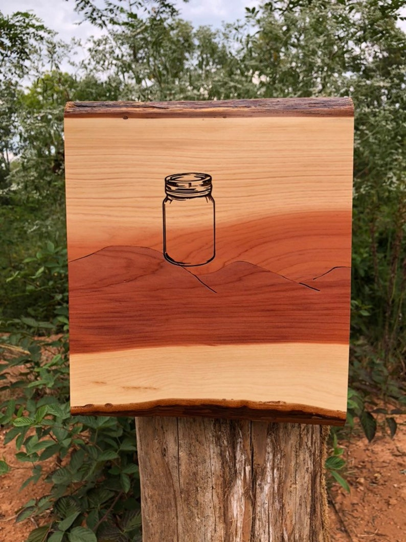 In the Mountains series cedar wall plaque with jar engraving image 0