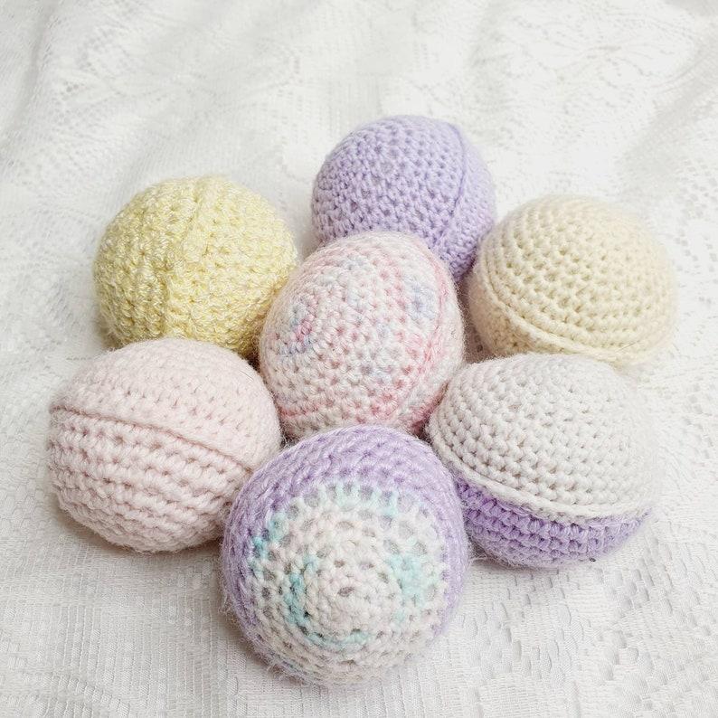 Handknitted wool ball rattles.