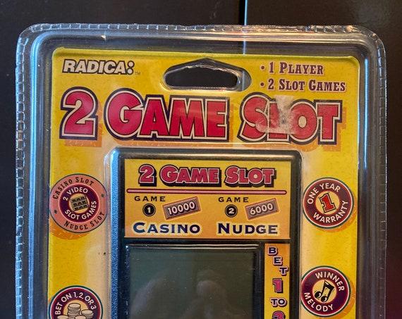 SLOTS 2 NUDGE Game Electronic Handheld Travel Game Radica Slot Game