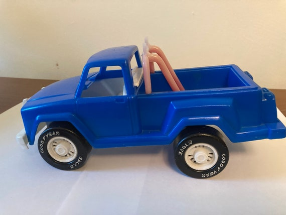 Vintaqge American Plastic Toy Inc Blue Pickup Truck With Good Rear Eagle Tires and a Roll Bar