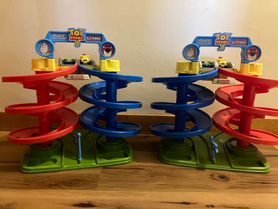 1990's Vintage Fisher Price Buzz and Light Year Spiral Race Track Complete with Race Cars