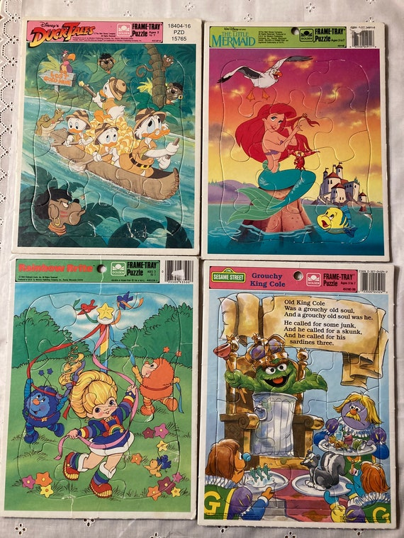 Four Whimsical Frame-Tray Puzzles Including Disney's Duck Tales; The Little Mermaid; Rainbow Brite and Sesame Street Grouchy King Cole
