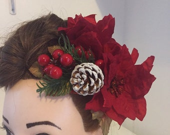 Hair clips Christmas poinsettia pine cones and berries.