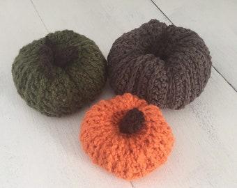 Set of three crochet pumpkins