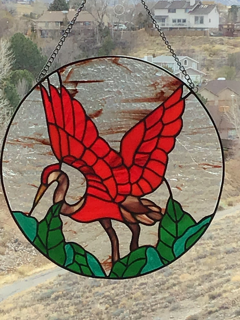 A Heron in Paradise stained glass circular panel