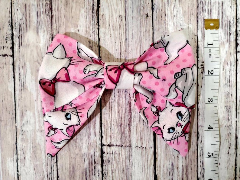 Disney Inspired Marie Bow Disney Inspired Bow ***PATTERN WILL VARY*** Hair Bow Aristocats Bow Hair Clip