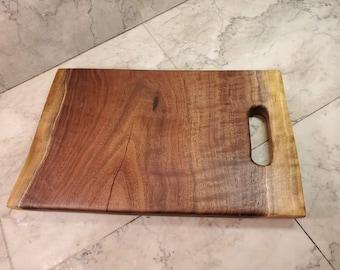 walnut cutting board with handhold
