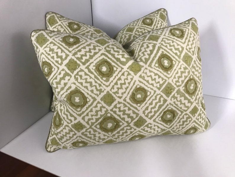 Pair of Raoul textiles pillows 19 x 19 Front  Mali  with a Green Cowtan texture back with zippers.