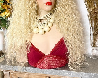 """613 blonde curly hair 