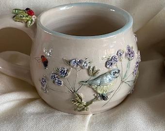 Handthrown birds bees and lady bird ceramic mug