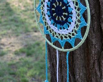 Circular crochet mandala, with reversible ring turquoise, blue, mint green, white