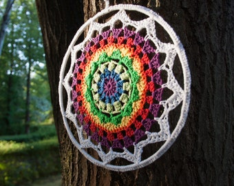Circular crochet mandala, with multi-colored reversible ring