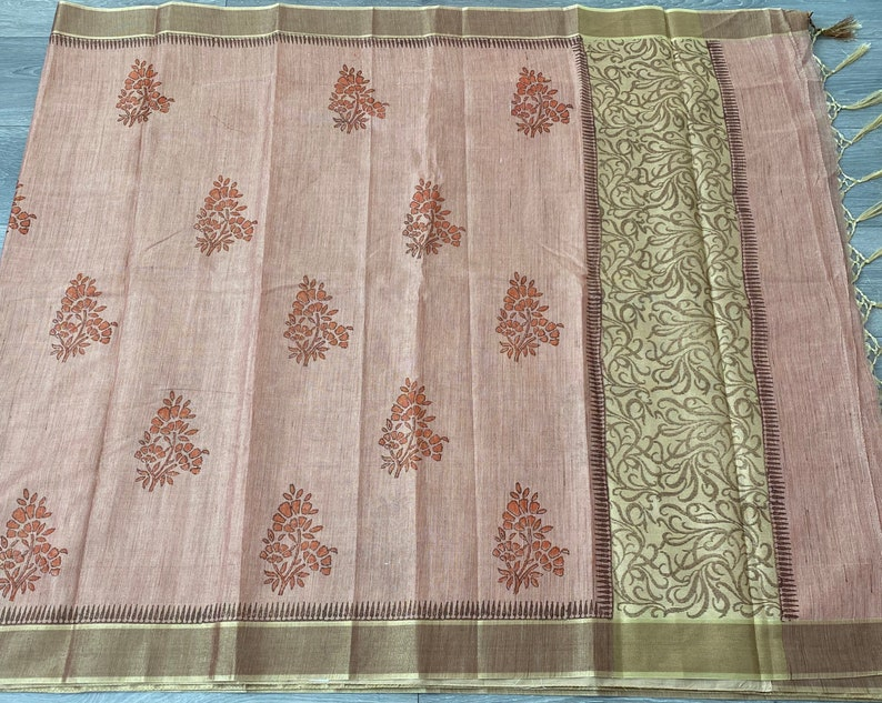 jute tissue falling saree with stitched blouse