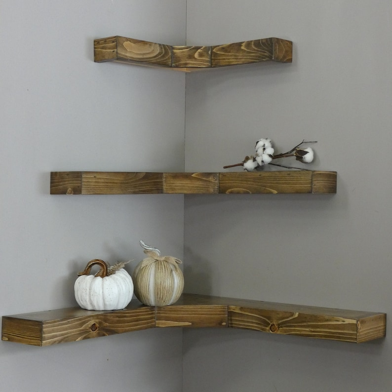 Small space living hacks are the best hacks for those who live in small places. Corner shelves are a great way to utilize space and a fun place for your decor.