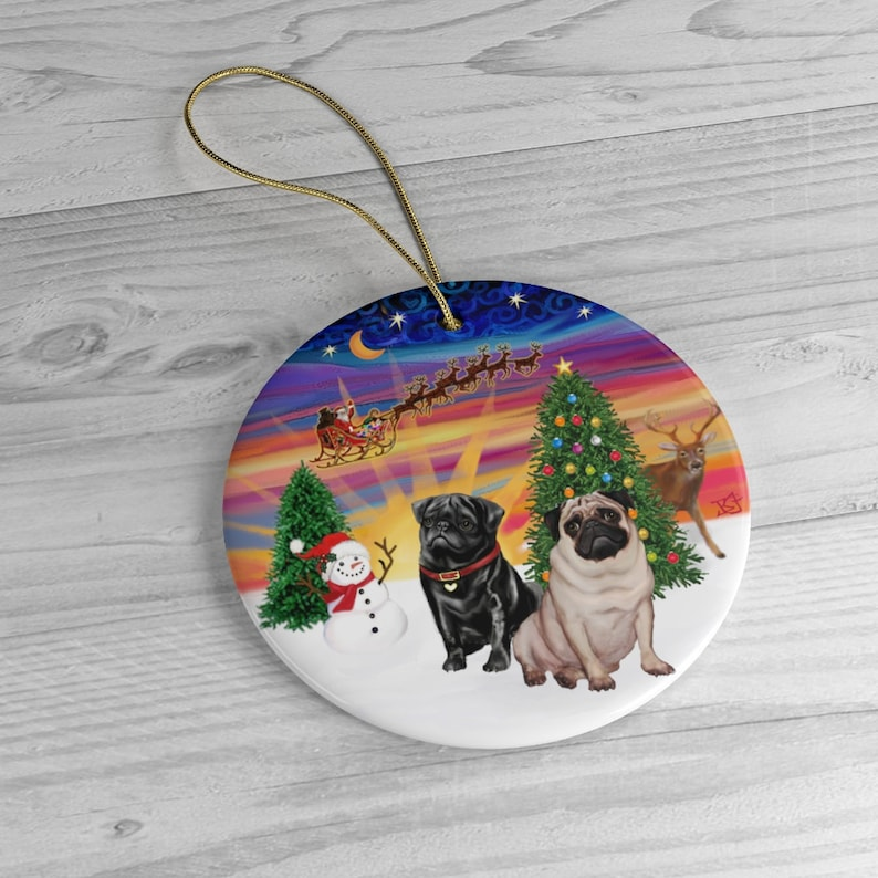 Two Pugs one black one fawn in Santa's Sunset image 0