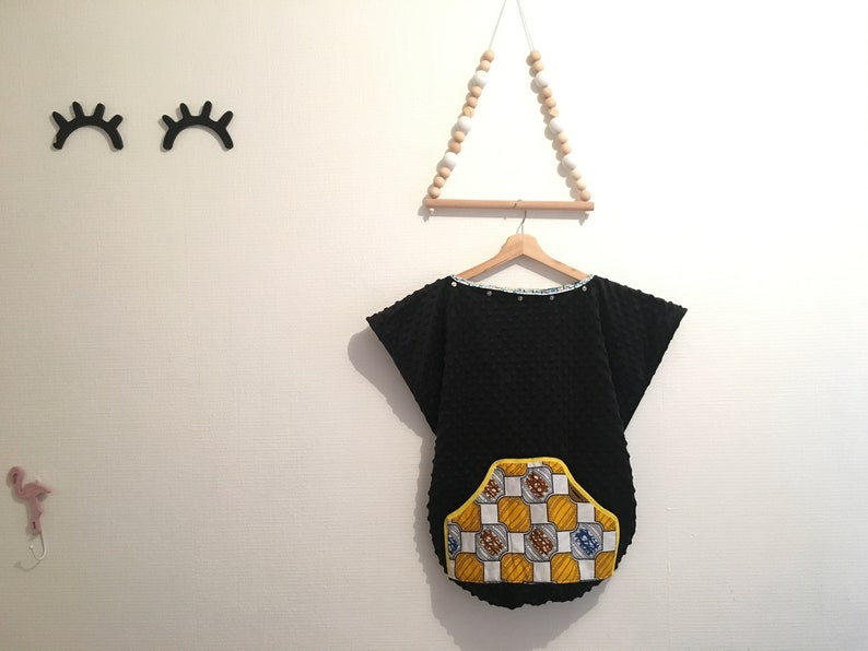 Baby carrying cape with wax key