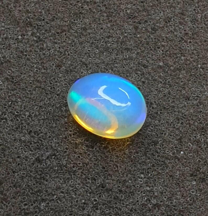 Natural White Welo Opal Beautiful Multi Fire Eithiopian Multi Opal Size 10X8X6 mm Cts 2.20 Oval Shape Opal Cabochon Gemstone Jewelry Making