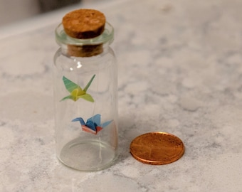 Micro Origami Cranes in a Bottle