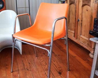 Orange plastic chair from the 70s