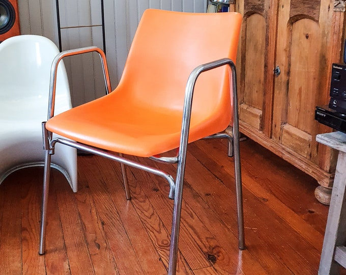 Featured listing image: Orange plastic chair from the 70s