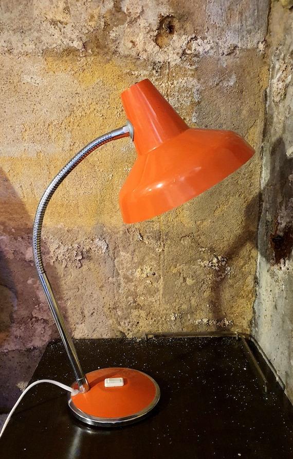 Large orange laying lamp