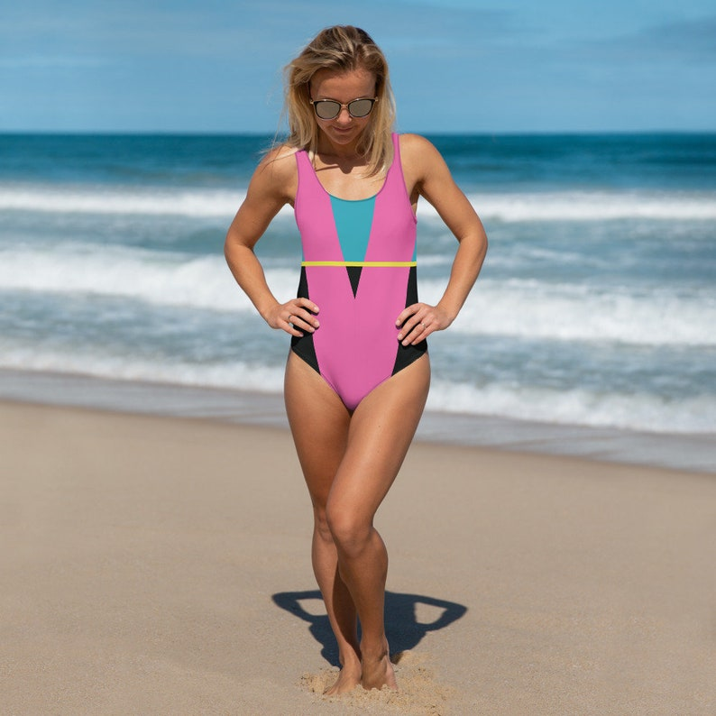Girl on beach wearing a 1980s One Piece Geometric Swimsuit