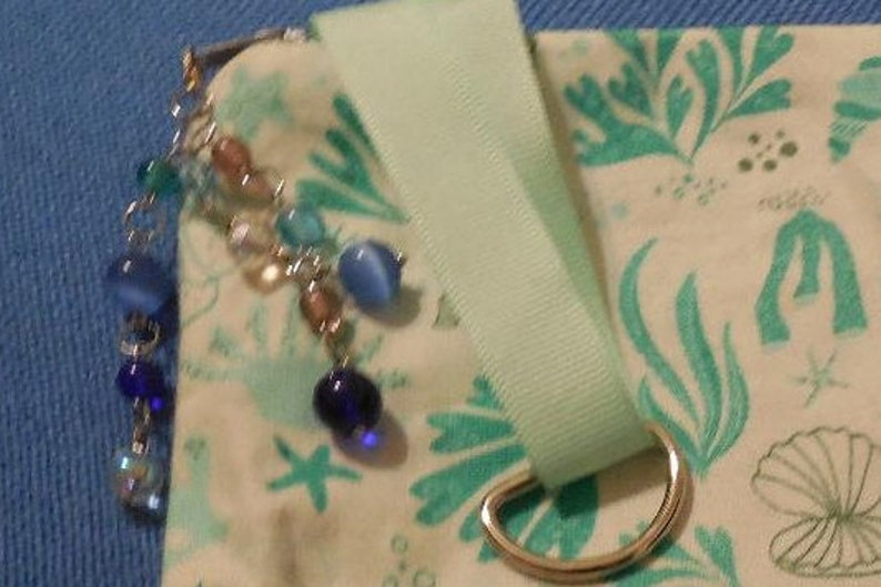 Coral Pouch with charm