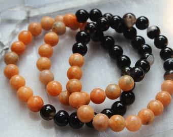 Fall Vibes   Halloween Gemstone Bracelet   Orange Calcite + Black Agate   Autumn Jewelry   Gemstone Stretch Bracelet   Pumpkin  Coastal Haze