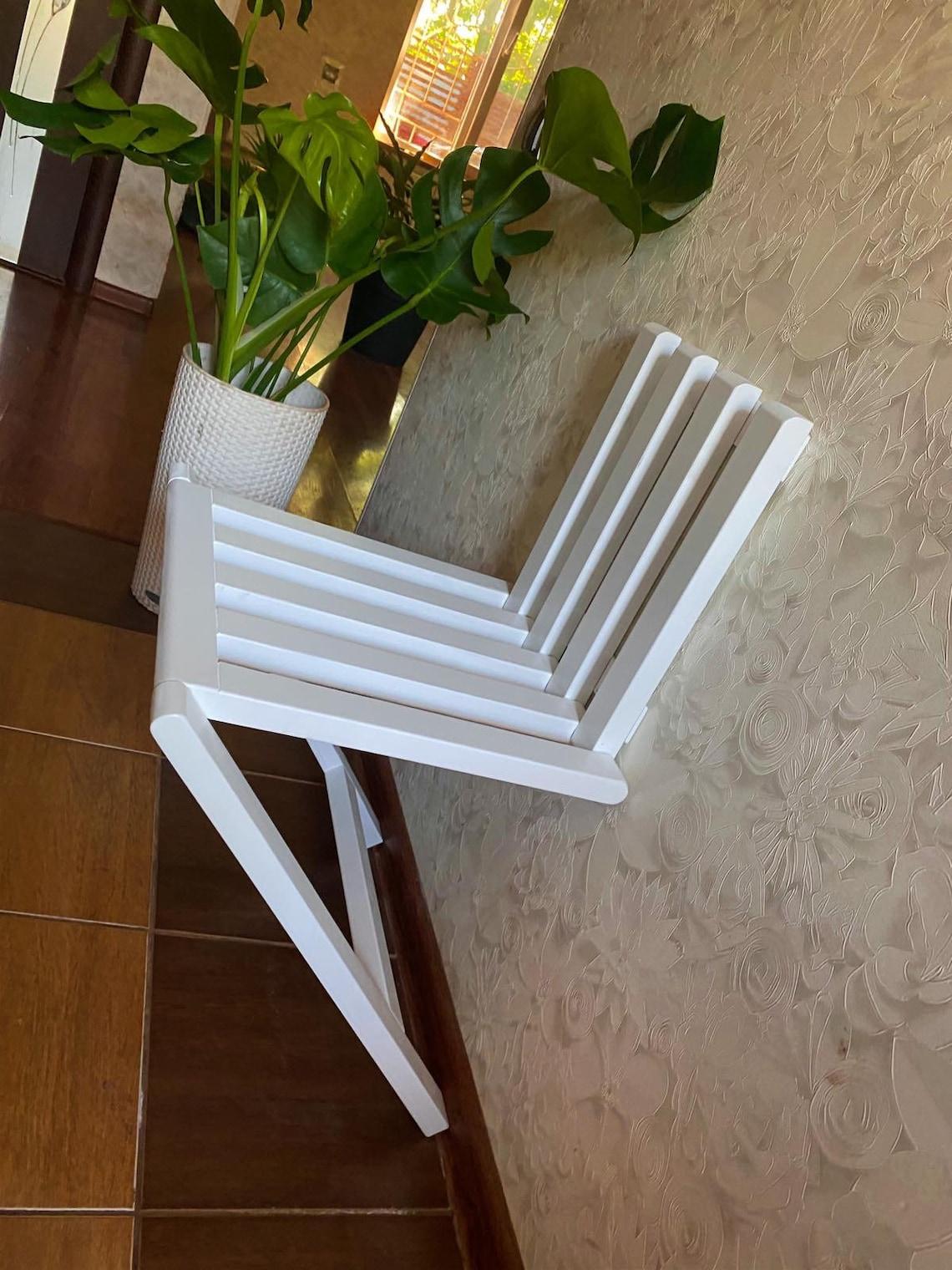 folding chair in the hallway, folding chair, hallway chair, hallway folding chair, wall-mounted folding chair