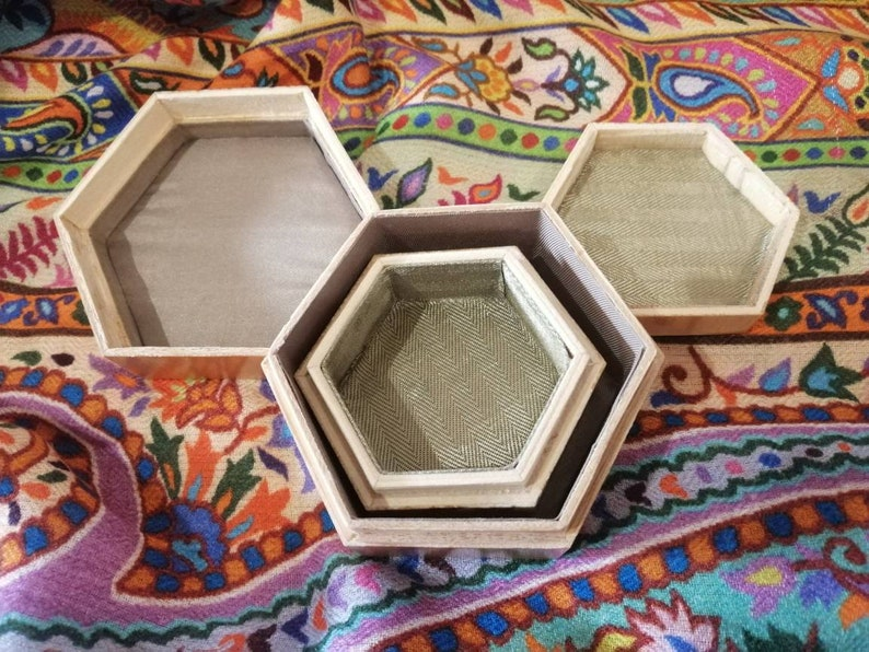 made in China pre-2000. Pair of vintage hexagonal Chinese wooden trinket boxes lacquered exterior and fabric-lined interior with fitted lid