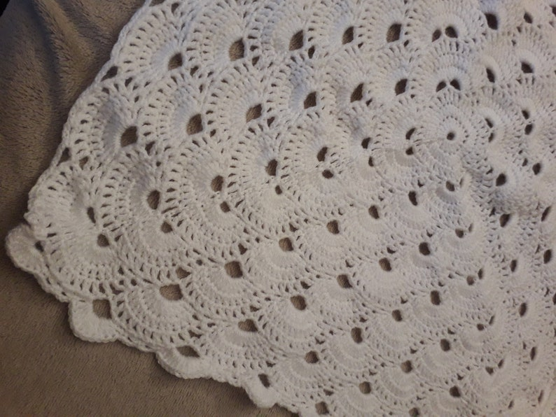 Baby blanket and bootees in a keepsake case