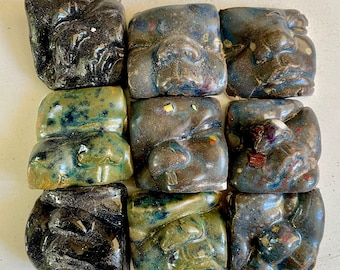 NINE (9) pieces grody nasty grab-bag low fire earthenware smushy baby face decoration