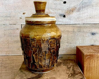 Small kurinuki-style handmade lidded jar with amber glaze - one of a kind