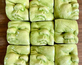 NINE (9) pieces Mr Yuck Green porcelain shiny glazed smushy baby face decoration