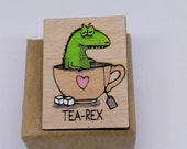Humorous T. Rex brooch in a recycled wooden tea cup, recycled wooden dinosaur badge for tea lovers