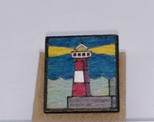 Hand painted recycled wood lighthouse brooch, handcrafted marine theme badge in upcycled wood, elegant lighthouse at night  brooch