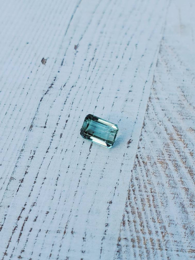 Unique gemstone 2 carats Very clean Beautiful luster Natural greenish-blue tourmaline Great for jewelry or your gem collection.