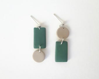 Nail earring and silver-colored metal ring, sand and green polymer clay shape. Modern jewel for women