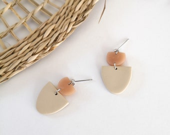 Silver earring, pink half-round and beige polymer clay, silver-colored metal nail. Modern jewel for women