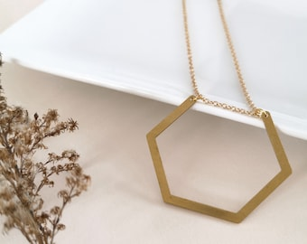 Short gold-plated chain necklace, brass pendant. Modern jewel for women