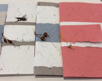 """Booklet hand made rag paper and seaweed.  10.5 """"X 7"""" . 12 pages"""