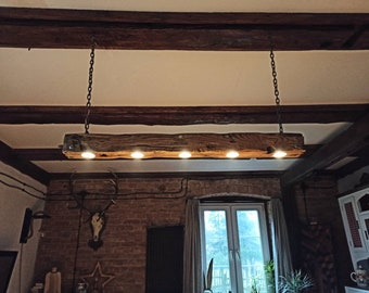 Rustic beam lamp. Climatic hanging lamp. Lamp from the old beam. Wooden lamp on chains. Lighting in a rustic style