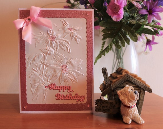 Handmade Birthday Card. Embossed floral pearlescent paper, dusky pink textured frame and sentiment,  bow and jewels, personalise