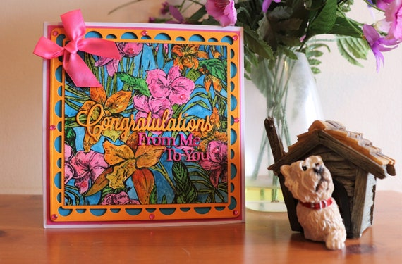 Unique Handmade Congratulations Card, bright and vibrant with stamped and hand painted background of tropical flowers, gems and bow