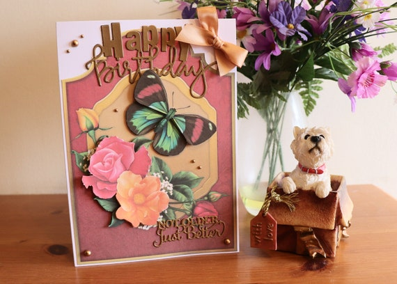Handmade Birthday Card with pretty spray of 3D decoupage flowers and butterfly, fancy die cut sentiment, gold beads and bow embellishments