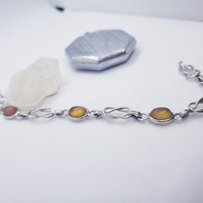 7 Inches Sterling Silver Oval Amber Cabochon Bracelet with Interlocking Loop Links